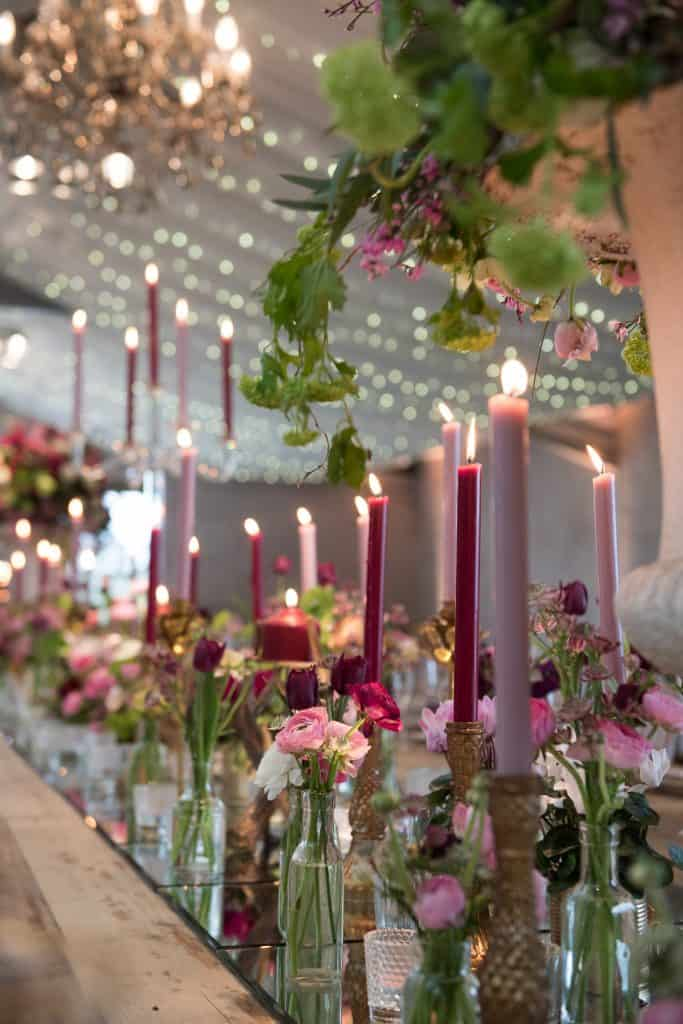 Purple and pink themed table arrangements