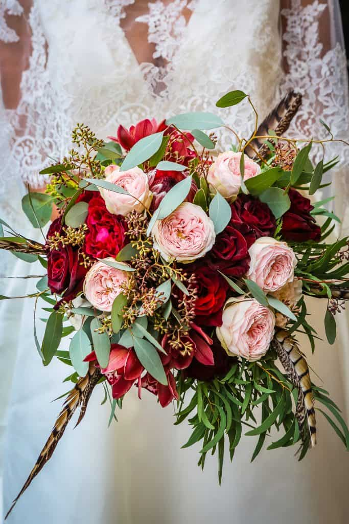 burgundy roses feathers bridal bouquet