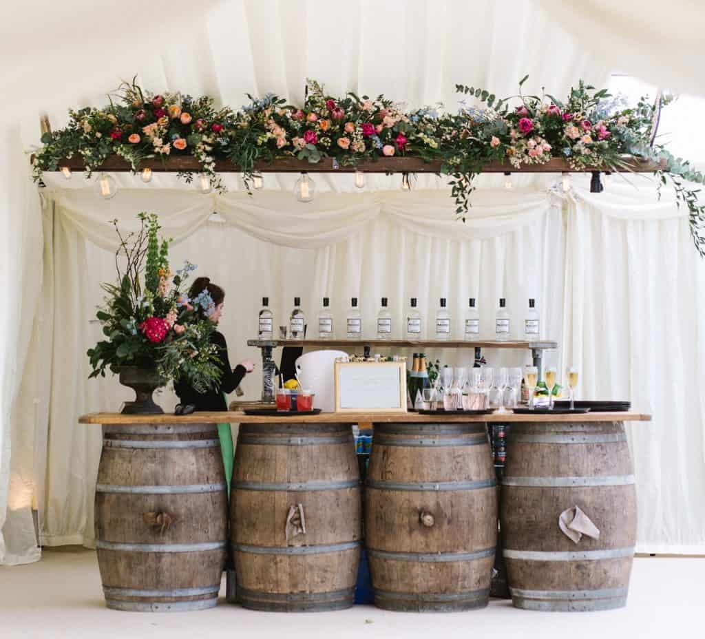 floral bar arrangement with barrels