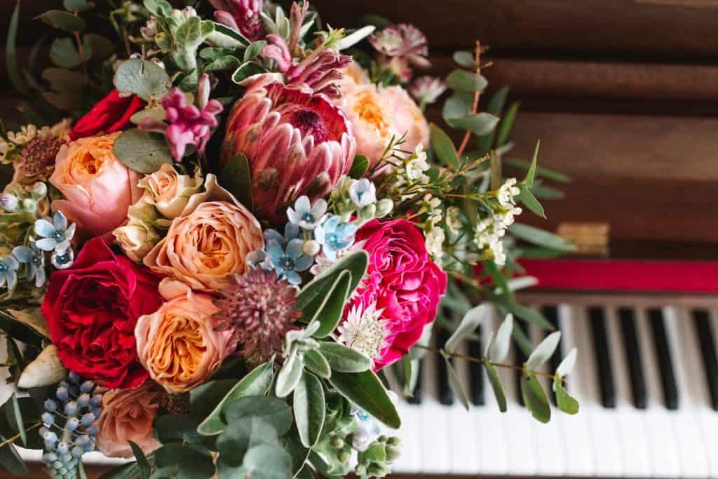 bridal bouquet including roses proteas