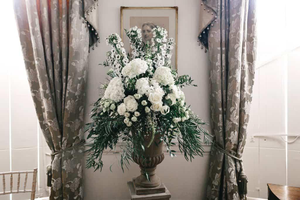 White and green pedestal arrangemnts