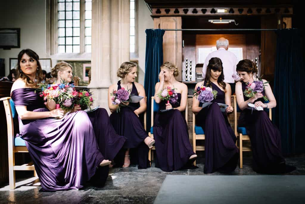 bridesmaids during ceremony bouquets