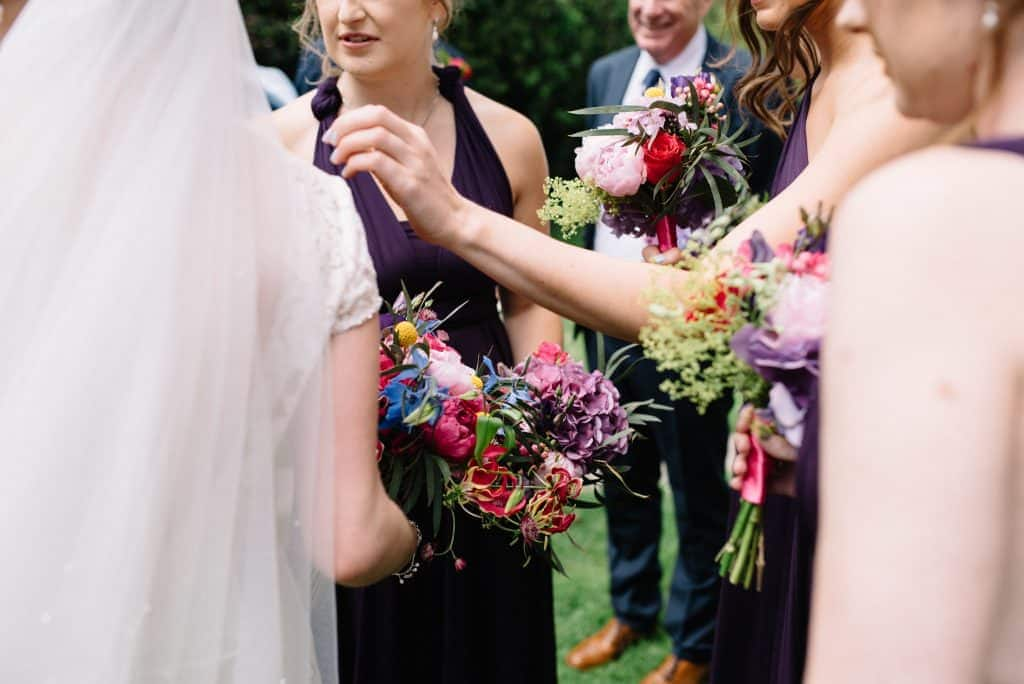 collection of purple bridesmaids bouquets