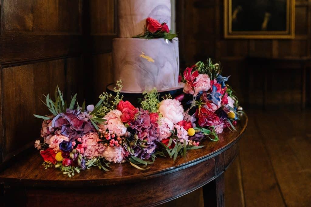 purple bridal flowers and cake