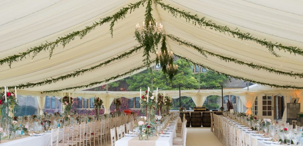 Candelabra on trestle tables with floral ropes
