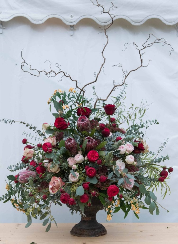 Floral arrangement in urn