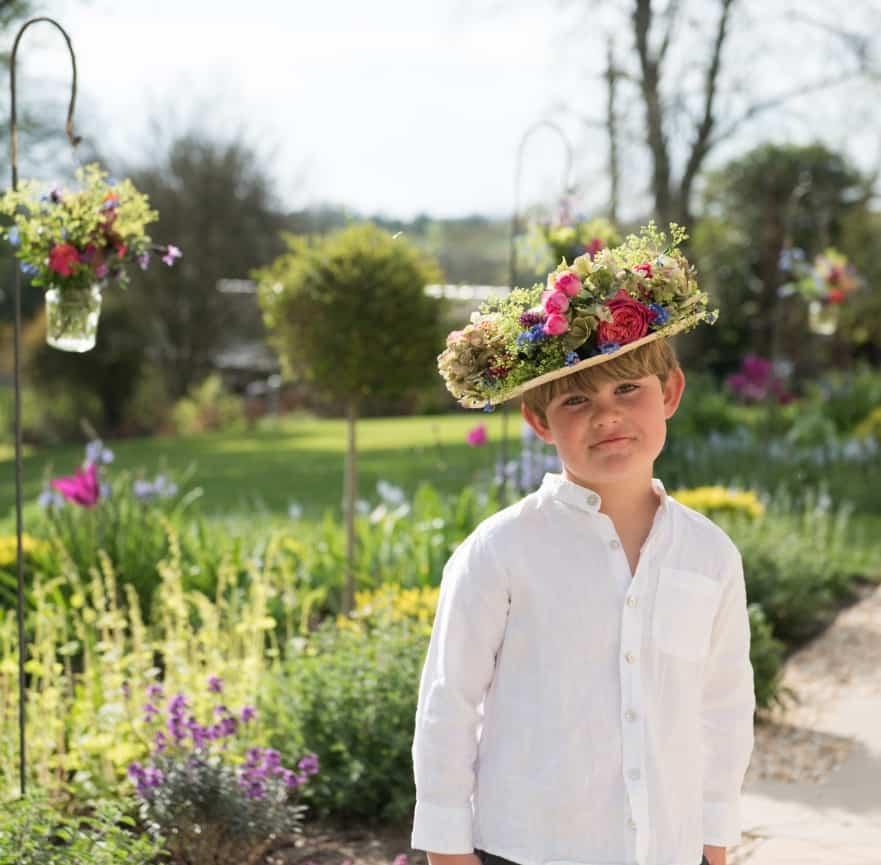 Floral hat arrangement with shepherds crooks
