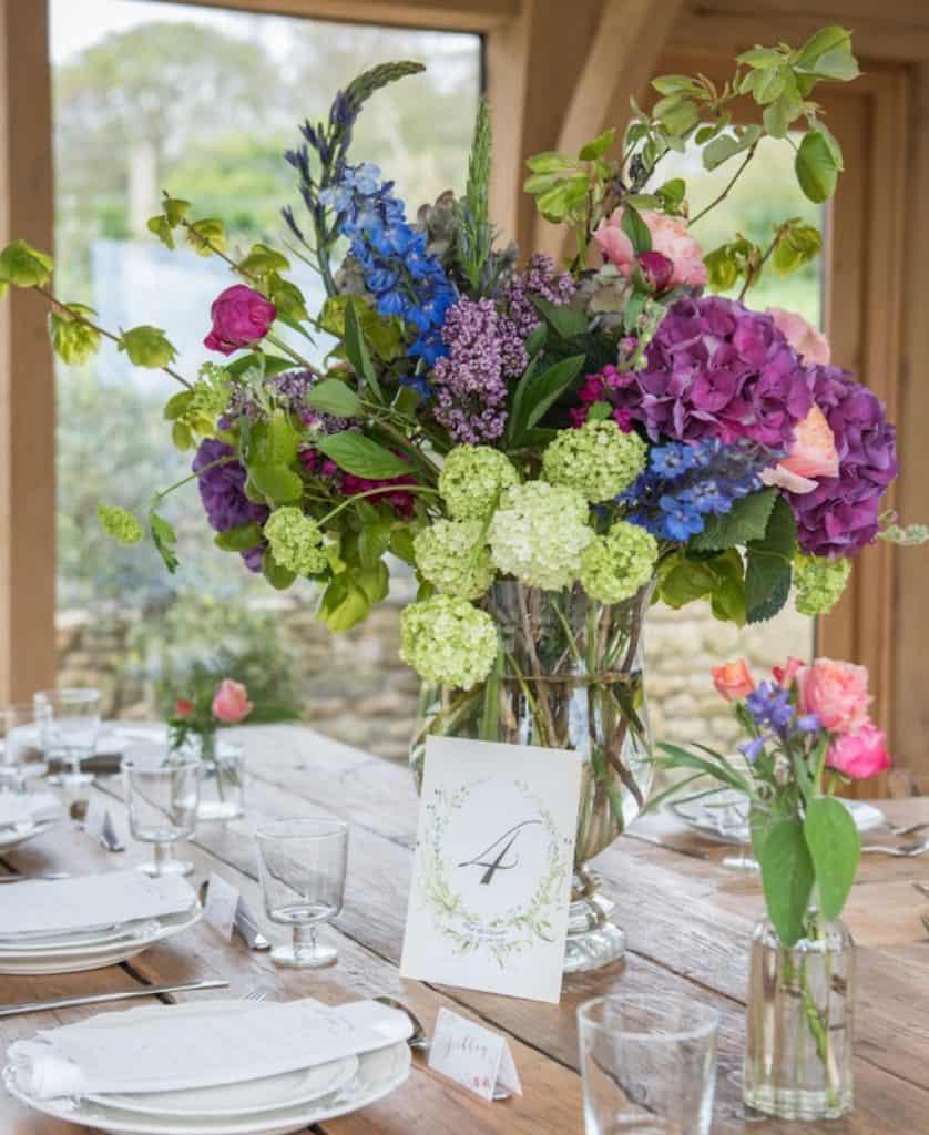 large vase arrangement bright colours