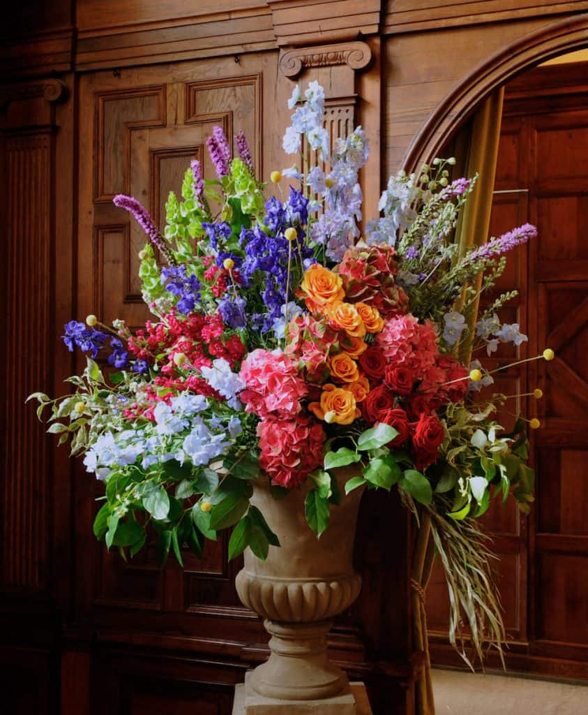 Bright pedestal arrangement next to archway