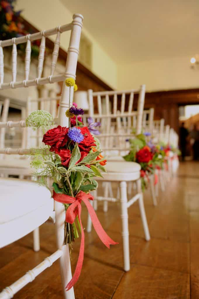 Red roses in aisle decorations