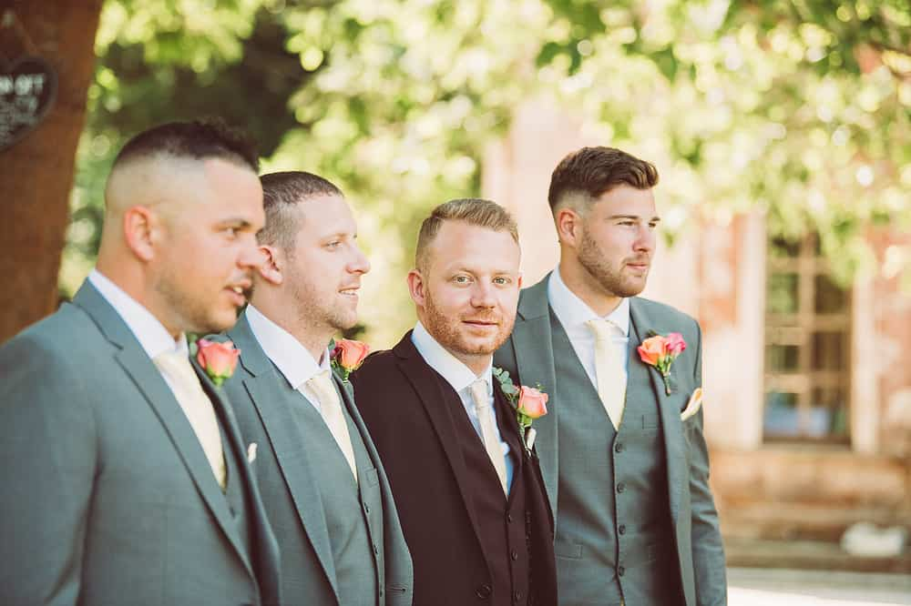 Pink buttonholes on bridal party