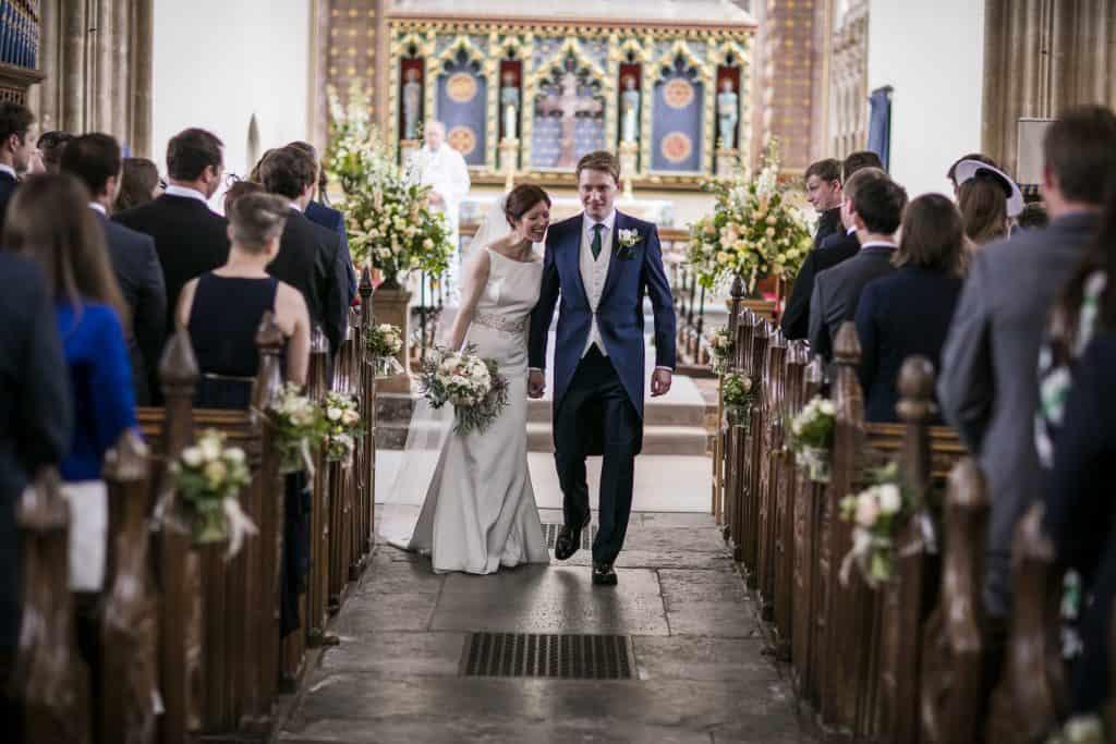 Church arrangements including bridal bouquet