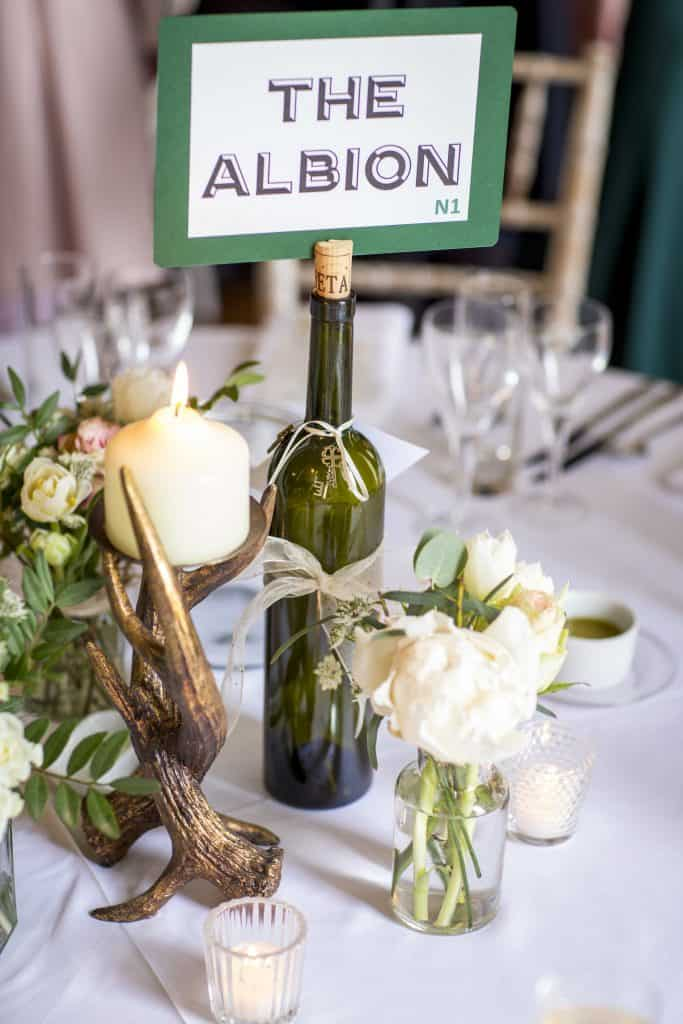Green and white table arrangements
