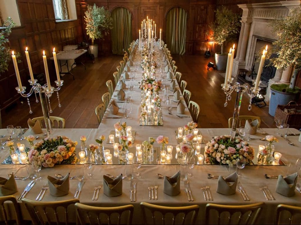 Tables arrangements at North Cadbury Court using mirror plates and candelabra