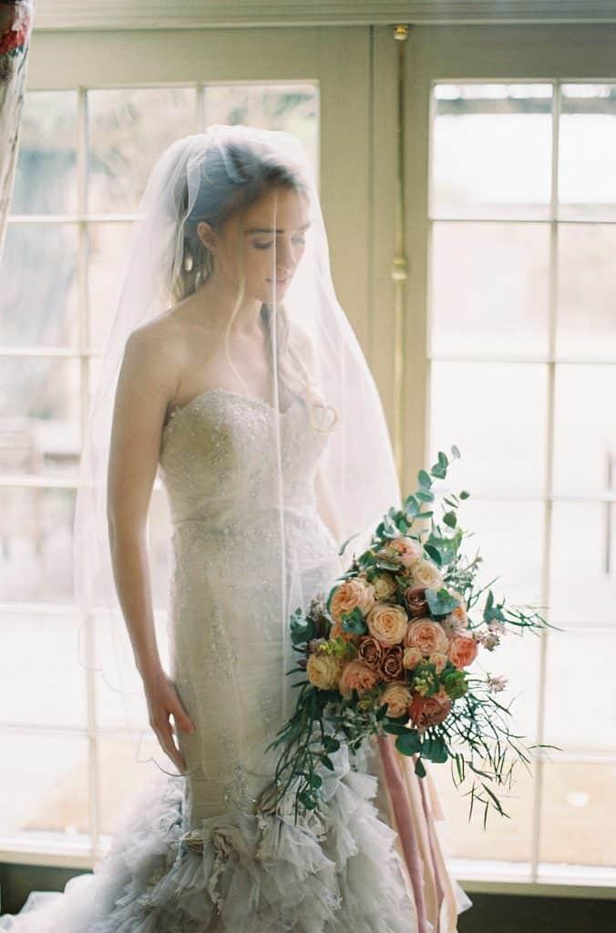 bride holding blush bouquet