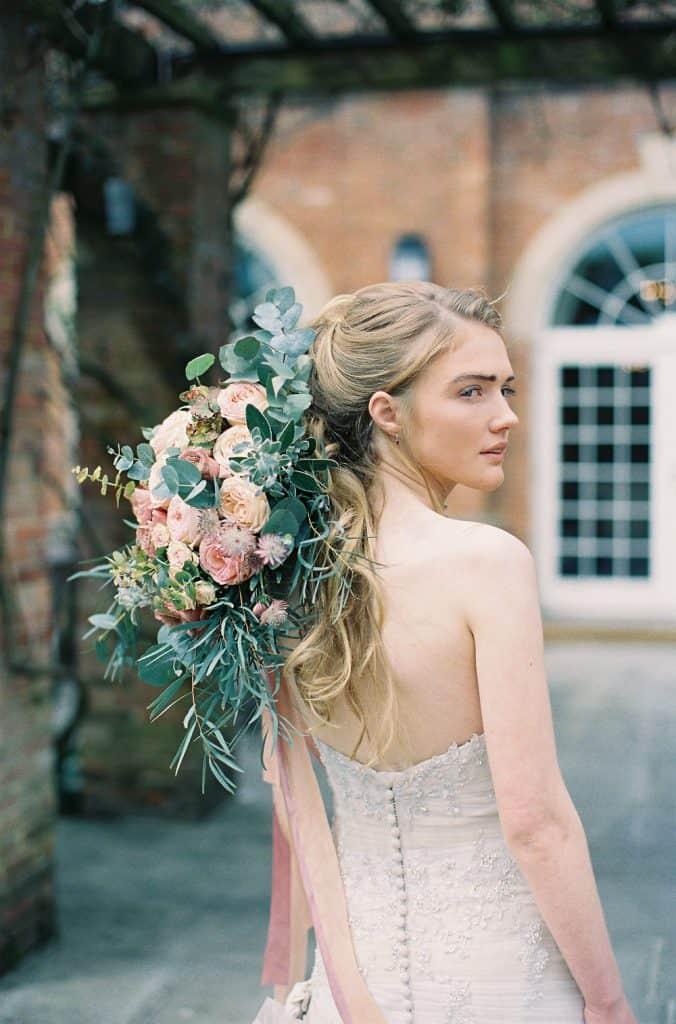 bride with bouquet over shoulder