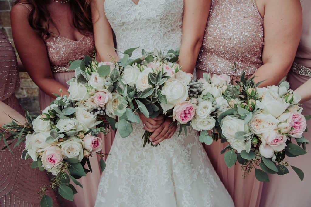 white and blush rose bridesmaids bouquets