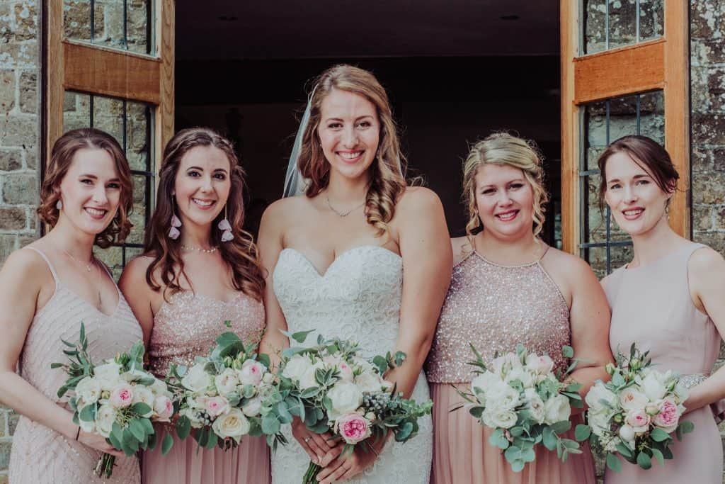 Bridesmaids and blush and rose bouquets