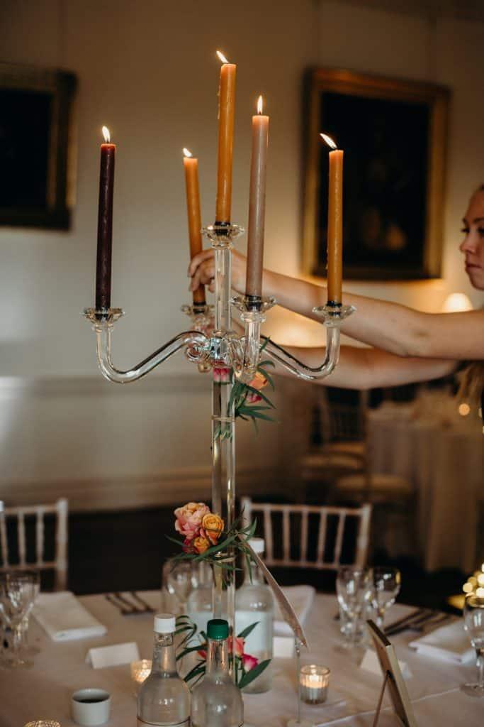 lighting candles for wedding breakfast