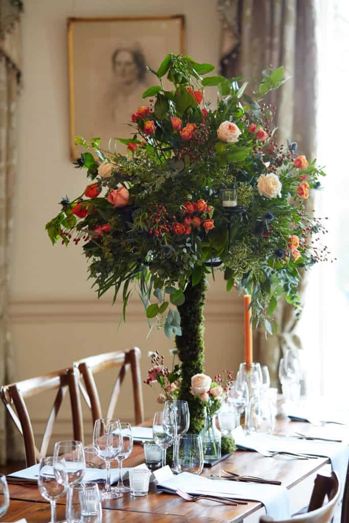 mossed candelabra table centres