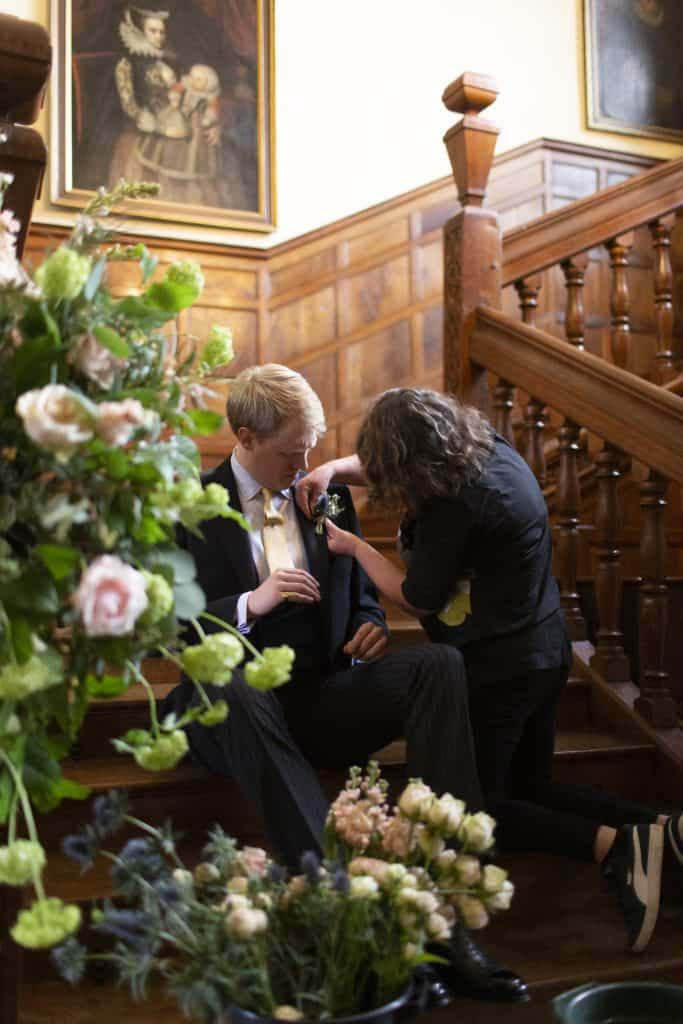 pinning buttonhole on flowers
